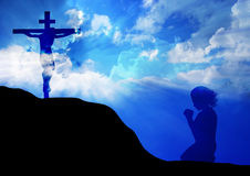 Prayer at the Cross. Woman praying under the cross Royalty Free Stock Images