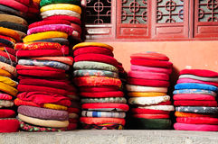 Prayer Cushions. Mulit-colored Buddhist prayer cushions stacked up against a wall on the inside of Mingjiao temple in Hefei China royalty free stock photos