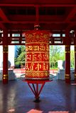The prayer drum in a Buddhist temple with ancient prayer letters stock photo