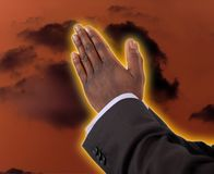 Prayer Of Fire. This is an image of businessman with hands in a prayer posture. This is image can be used to represent Prayer Of Fire themes. The yellow/orange Stock Photography