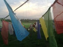 Prayer Flag Nepal Lumbini. Nepal Sutras, originally written on cloth banners, were transmitted to other regions of the world as prayer flags.[3] Legend ascribes Stock Photography