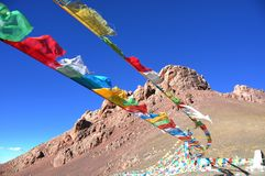 Prayer Flags. Tibetan believe paryer flags can bring good luck. The photo was taken in the peak of Nagenna, Tibet, China Royalty Free Stock Photo
