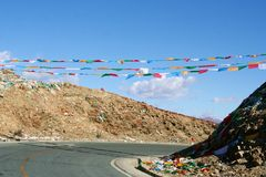 Prayer Flags. Across a road in Tibet Royalty Free Stock Photos