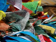 Prayer Flags. Are colorful panels or rectangular cloths often found strung along mountain ridges and peaks high in the Himalayas to bless the surrounding Royalty Free Stock Photos