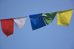 Prayer Flags against a Blue Sky Stock Photo