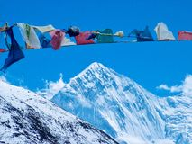 Prayer flags on Annapurna mountain, Himalayas royalty free stock image