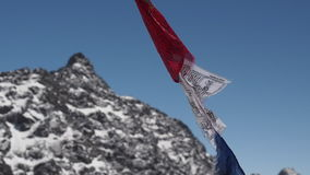 Prayer flags blowing in the winds of Himalayas mountains stock video footage