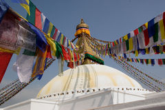 Prayer flags at a Buddhist temple. Prayer flags hanging up at a large Bhuddist stupha in Kathmandu, Nepal Stock Photos