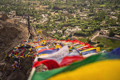 Prayer flags and City in Leh Ladakh Royalty Free Stock Images