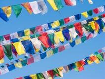 Prayer flags. Colorful Tibetan prayer flags against a blue sky Stock Image