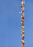 Prayer flags of different colors on blue sky Stock Image