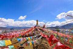 Prayer flags flying on the Pagoda or Stupa of Tibetan Temple sy stock images