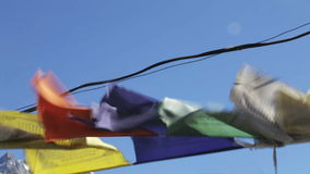 Prayer flags flying from the wind stock video footage