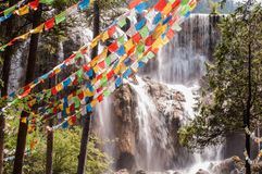 Prayer flags in front of the waterfall Royalty Free Stock Photos