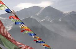 Prayer flags in front of the Yushu mountains Stock Photography