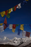 Prayer flags with himalaya mountains. Prayer flags with mountain landscape in the himalaya khangchengdzonga range, sikkim, india Royalty Free Stock Photography