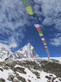 Prayer flags in the Himalayas. Trekking in the Himalayas, Nepal, Asia. On way to Everest Base camp. Prayer flags and mountain Stock Images