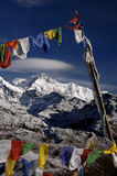 Prayer flags and khangchengdzonga peak. Prayer flags and khangchengdzonga (Kangchenjunga) peak (worlds third highest mountain 8586 meters above sea level) in the Royalty Free Stock Photo