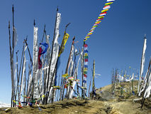 Prayer Flags - Kingdom of Bhutan. Buddhist Prayer Flags on a mountain top in the Himalayas in the Kingdom of Bhutan stock photography