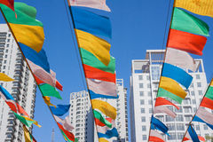 Prayer flags In modern city Royalty Free Stock Photo