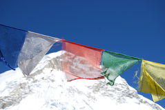 Prayer Flags & Mount Everest. Row of brightly coloured Prayer flags strung in front of Mount Everest Stock Photography