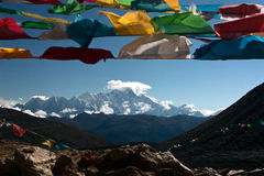 Prayer flags  and the Namjagbarwa Stock Photo