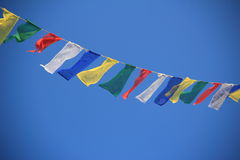 Prayer flags in Nepal. A row of colorful prayer flags in Nepal Royalty Free Stock Photography