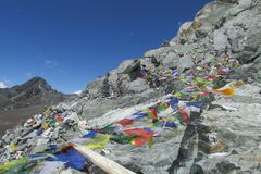 Prayer flags in Nepal trekking at Himalaya mountains. Tibetan colorful prayer flags in Nepal trekking at Himalaya mountains snow summits royalty free stock photos