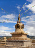 Prayer Flags of Northern Yunnan. Prayer flags strung around a stupa in northern Yunnan province in China Royalty Free Stock Image