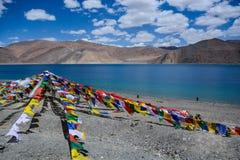 Prayer flags at Pangong Lake. Five colors prayer flags among Pangong Lake landscape in Leh , Ladakh, India royalty free stock image