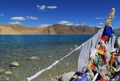 Prayer Flags. The prayer flags and the Pangong Lake , Ladakh, together offer a most serene and spiritual scene Stock Photos