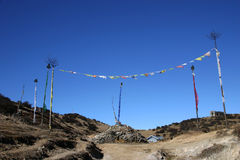 Prayer flags and prayer stones, northeast India Royalty Free Stock Photo
