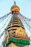 Prayer flags,  small gilded stupa at the Swayambhunath temple in Royalty Free Stock Photo