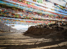 Prayer flags spanning a road on a mountain pass, Tibet Stock Image