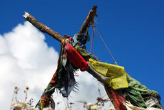 Prayer flags streamer under blue sky Stock Photo