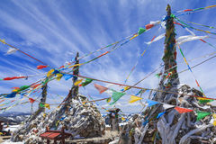 Prayer flags and stupa at the top of Blue Moon Valley, Yunnan, China Stock Photography