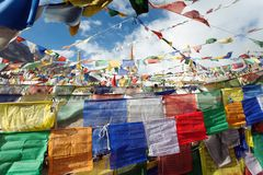 Prayer flags with stupas Stock Photo