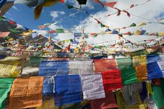 Prayer flags with stupas Royalty Free Stock Photos