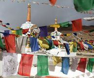 Prayer flags with stupas - Kunzum La pass - India Stock Photo