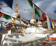 Prayer flags with stupas - Kunzum La pass - India Royalty Free Stock Photo