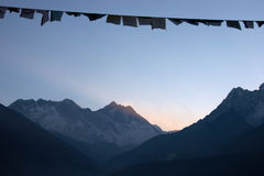 Prayer flags at sunrise, Himalaya mountains, Nepal Royalty Free Stock Image