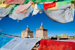 Prayer flags surround a tibetan monastery Royalty Free Stock Image