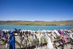 Prayer flags in Tamgaly Tas - a site with Buddhist rock carvings in Kazakhstan Royalty Free Stock Image
