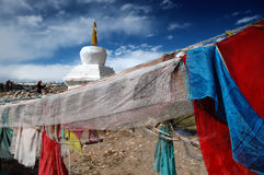 Prayer flags in Tibet. Prayer flags and buddhist stupa in the small village of Hor i Western Tibet Royalty Free Stock Photo