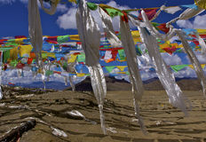 Prayer flags in tibet. Prayer flags fly on the tibetan skyline Stock Photo
