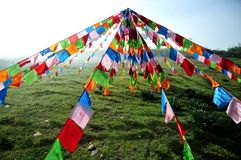 Prayer flags. Tibetan prayer flags are often seen in the area, it is a religious belief Stock Photos