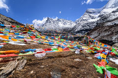Prayer flags. On the top of snow mountains Stock Photo