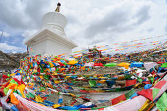 Prayer flags with white tower Royalty Free Stock Photo