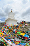 Prayer flags with white tower Royalty Free Stock Images