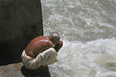 Prayer gratitude to life giving river Ganga India Stock Photography